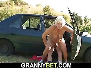 Adult woman on hitchhiking fucks a young guy